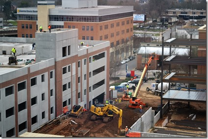 Construction crews continue work on the 30,000-square-foot Erwin Penland office building in downtown Greenville. The project is one of 25 different projects either underway or planned for the downtown area. (Photo by Bill Poovey)