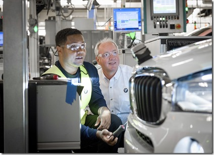 Manfred Erlacher (right), president of BMW Manufacturing Co., examines work being done on the production floor of the company's Spartanburg County plant. (Photo provided)
