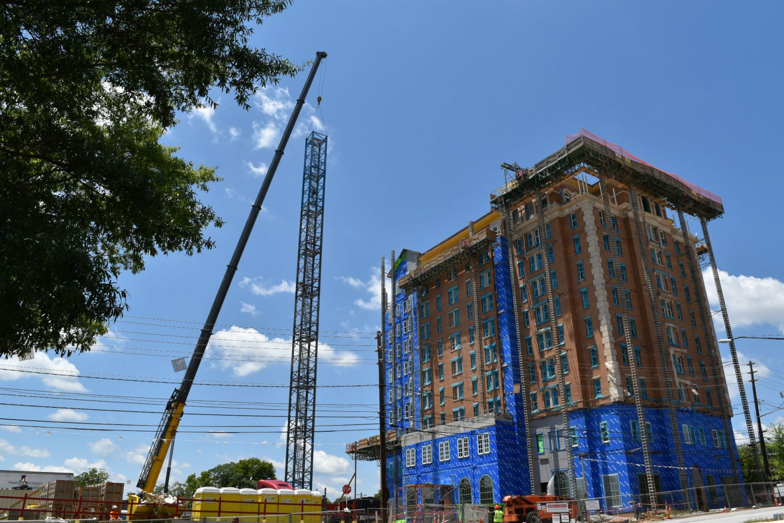 : The tower crane around the AC Marriott Spartanburg was recently taken down. Officials with OTO Development, developer of the downtown hotel, said work still remains on the inside and outside of the 10-story building before its fall completion. (Photo/Provided)