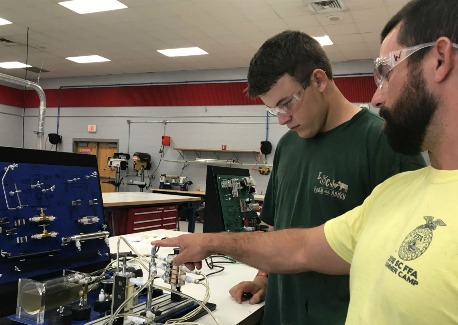 Hunter Richey, a junior at Belton-Honea Path High School, works with a hydraulic trainer under the instruction of his teacher Ben Woody. (Photo/Teresa Cutlip)