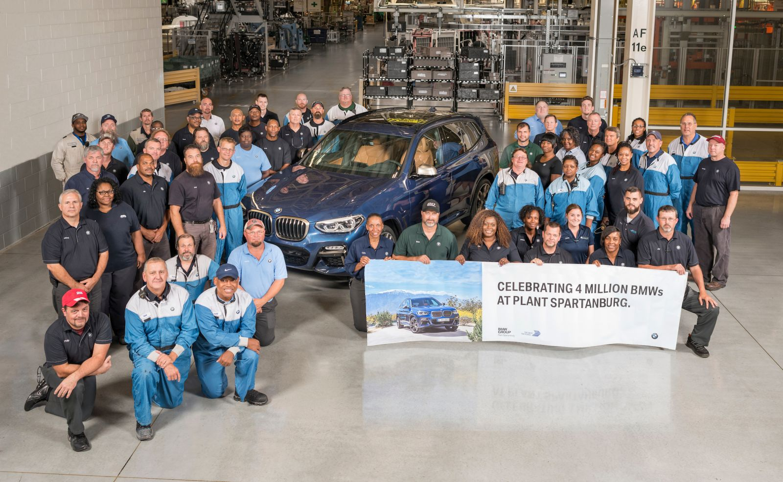 BMW associates celebrate the 4 millionth BMW produced in South Carolina. The X3 iDrive M40i came off the line on Friday. (Photo/Provided)