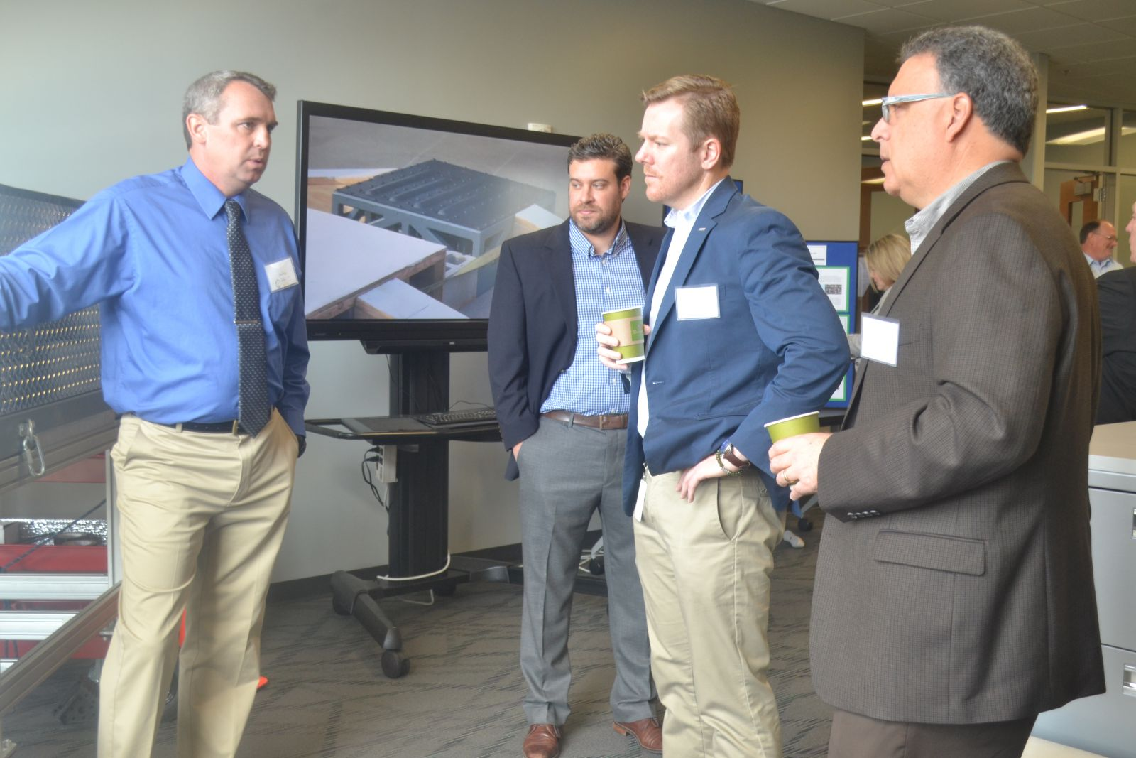 Jim Nigg, left, president and CEO of Constructis LLC, talks about kinetic energy during a media event Tuesday to announce the Manufacturing Business Incubator at the Center for Manufacturing Innovation. (Photo by Teresa Cutlip)