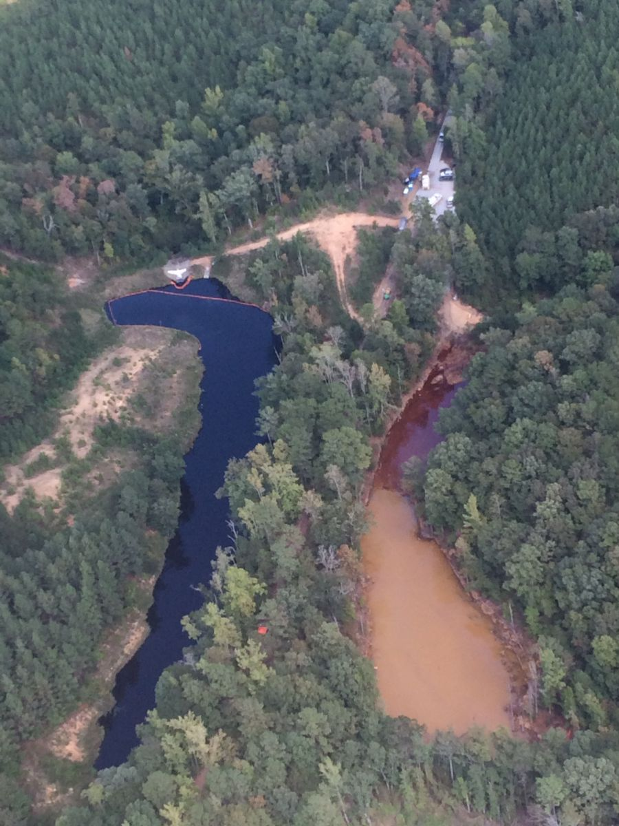 This aerial photo shows a man-made mine retention basins at a spill response site in Alabama. Georgia-based Colonial Pipeline said it has cleared the basin on the right of gasoline. The spill has caused fluctuations in gas prices and product availability in North Carolina and South Carolina. (Photo  provided)