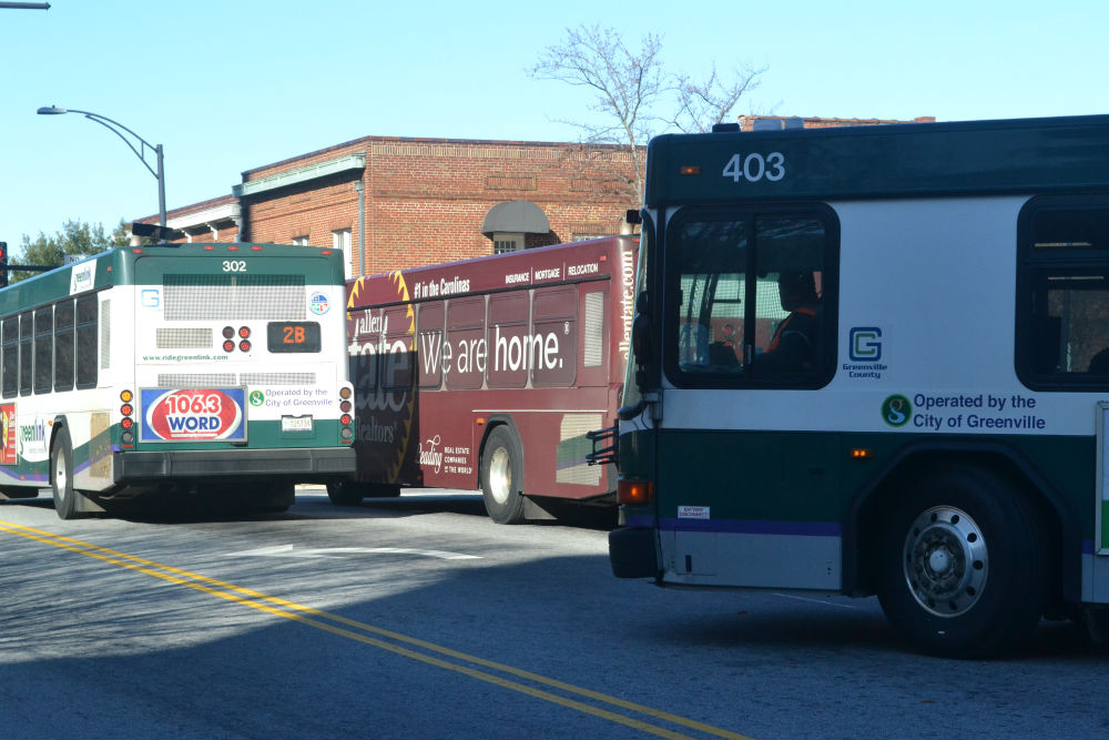 Greenlink buses pull out of the downtown terminal where they meet every hour during the weekday for passengers to transfer. (Photo/Ross Norton)