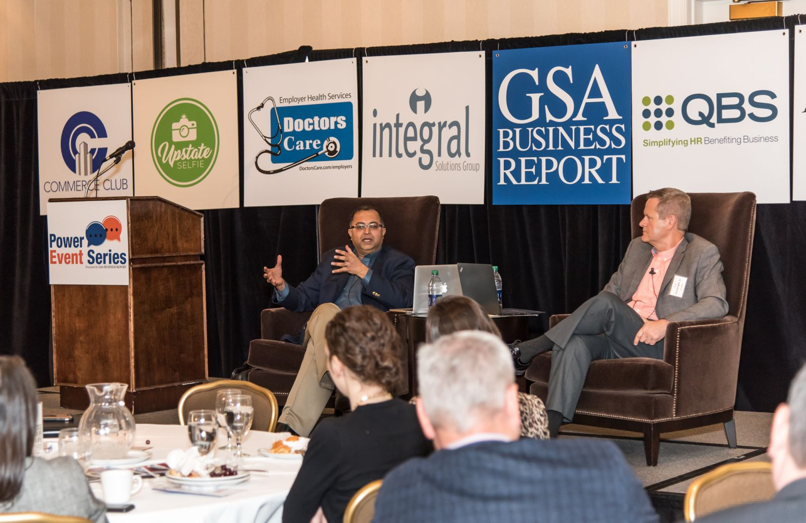 "Venkat Krovi, Michelin Endowed Chair at CU-ICAR, left, and Fred Cartwright, executive director of CU-ICAR, discussed autonomous vehicles Thursday during the GSA Business Report Power Event ""Transformation of the Auto Industry: A Road Map to the Future."" (Photo/Kathy Allen)"