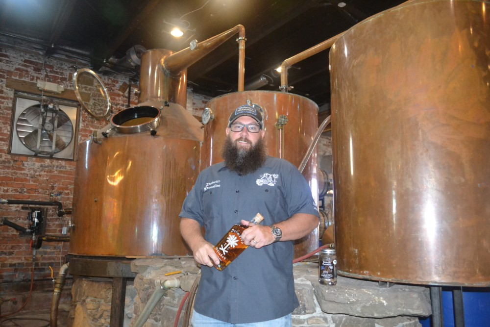 Trey Boggs, of Palmetto Moonshine, said he strives for authenticity in his work. (Photo/Teresa Cutlip)