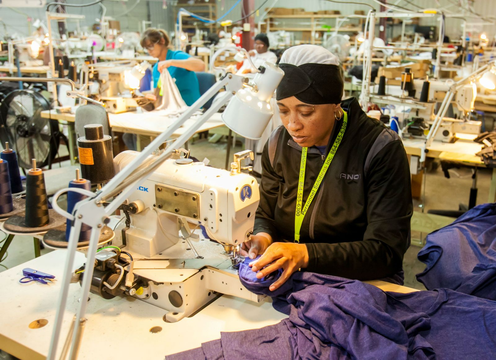 Taiwanna Rice sews sleeves of a T-shirt at Vapor Apparel's plant in Union. (Photo/Jeff Blake)