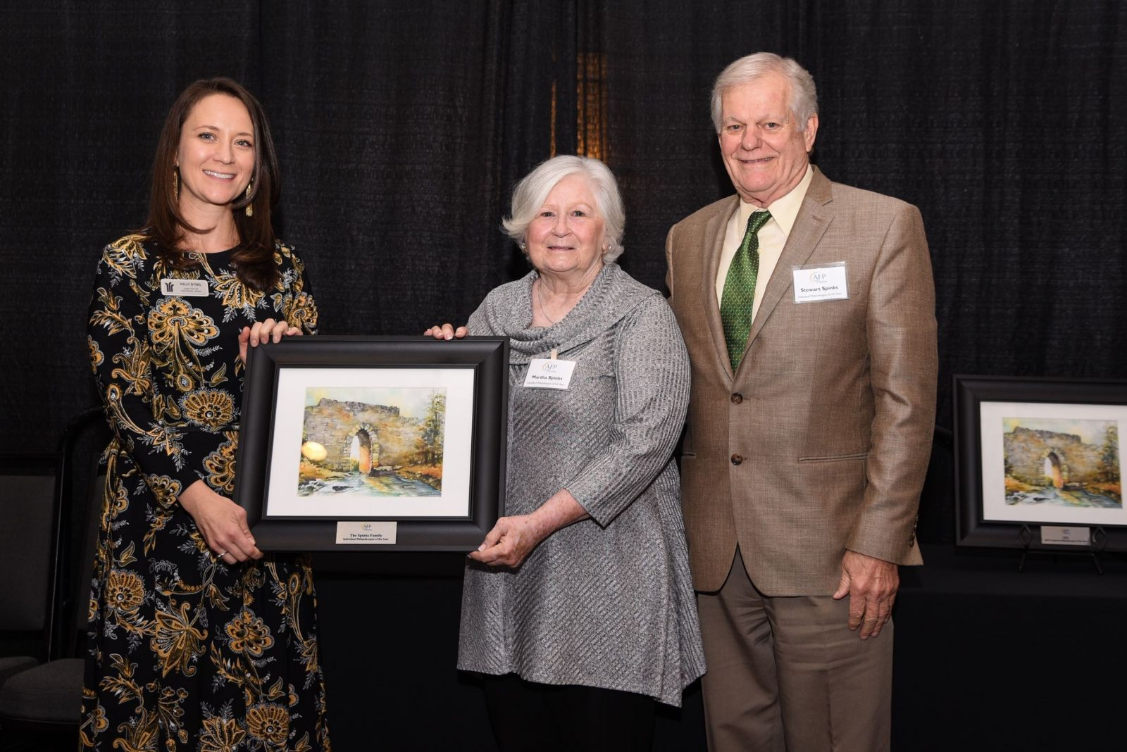 Martha and Stewart Spinks receive a rendering of the Poinsett Bridge in appreciation of their philanthropy.
